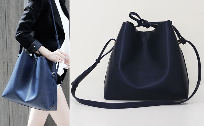 Changing The World With Angela Roi Handbags Jules Bucket Bag In Navy