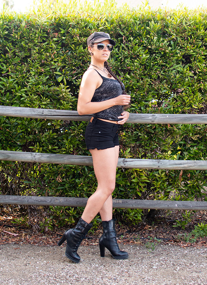 Wearing Fran Denim's Ivy Shorts in Black - Right Side View