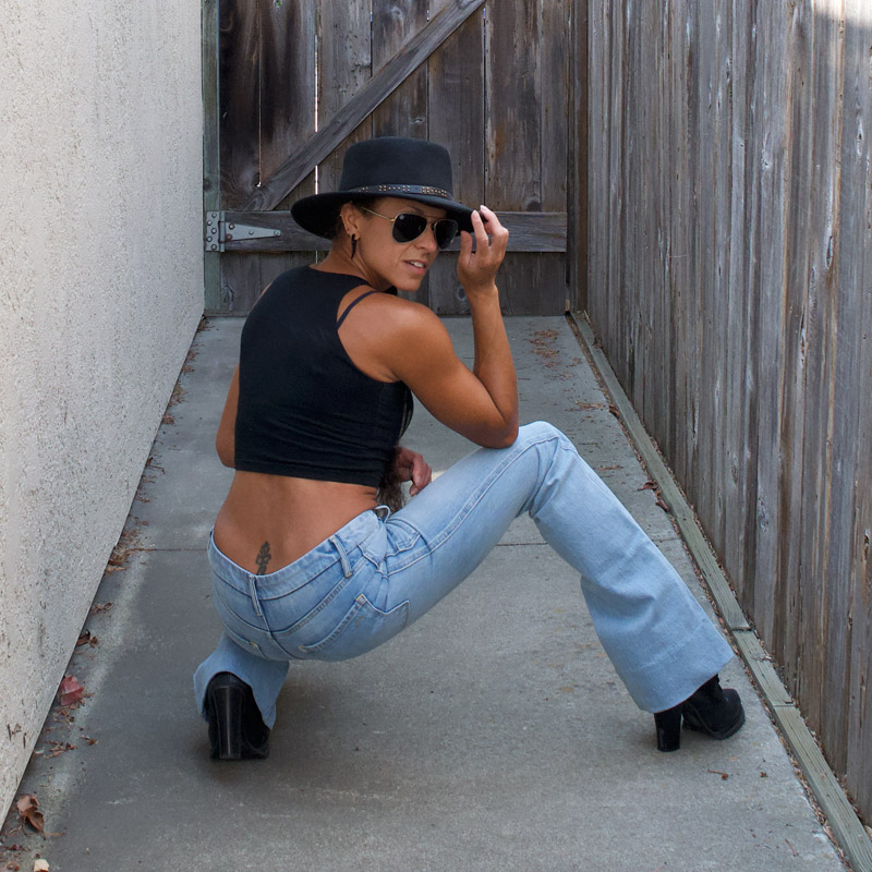 Porter Blue Apparel - Wanderer Flare Jeans - Squatting on Ground Back View